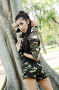Sexy women in army clothes woman at the park Stock Photos