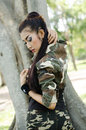 Sexy women in army clothes woman at the park Royalty Free Stock Photo