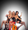Sexy women as a music band Royalty Free Stock Images