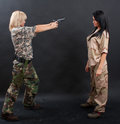 Sexy women in military outfit posing the studio Royalty Free Stock Image