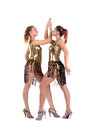 Sexy women posing in gold go-go costume isolated Royalty Free Stock Photos