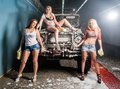 Sexy women washing car pretty young offroad by sponge Royalty Free Stock Image