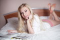Sexy young blond woman laying in bed Stock Photography