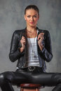 Sexy young blond woman in leather jacket pulling collar Royalty Free Stock Photo