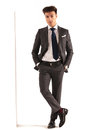 Sexy young business man with hands in pockets Royalty Free Stock Photo