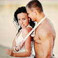 Sexy young couple at the beach having fun together Royalty Free Stock Photography
