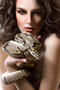 Sexy young dark hired woman posing topless holding a snake Royalty Free Stock Photo