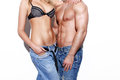 Sexy young fashionable couple body at white wall Royalty Free Stock Image