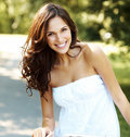 Sexy young female smiling in a park Royalty Free Stock Photos