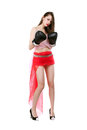 Sexy young lady posing in red skirt and boxing gloves isolated on white Royalty Free Stock Image