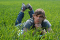 Sexy young man on green grass laying a meadow Royalty Free Stock Photography