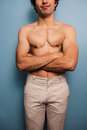 Sexy young man with his arms crossed is standing Royalty Free Stock Photo