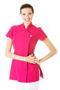 Sexy young masseuse in pink uniform isolated on white Royalty Free Stock Photo