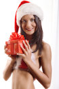 Sexy young santa girl with gift Royalty Free Stock Images