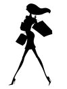 Sexy young shopper silhouette of a chic woman with shopping bags Stock Photo