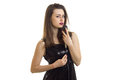 Sexy young singer with a microphone in her hand and a black dress Royalty Free Stock Photo