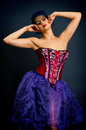 Sexy young woman fashion dress girl red corset dark background Royalty Free Stock Photo