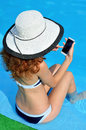 Sexy young woman in a hat with a wide brim with a telephone near Royalty Free Stock Photo