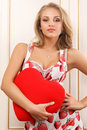 Sexy young woman holding heart Royalty Free Stock Photography