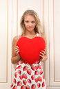 Sexy young woman holding heart Stock Photos