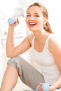 Sexy young woman lifting weights at lifestyle gym portrait of healthy happy holding dumbbell Stock Photography