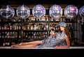 Sexy young woman lying on the bar at a night disco club nightclub Royalty Free Stock Photos