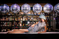 Sexy young woman lying on the bar at a night disco club nightclub Stock Photography
