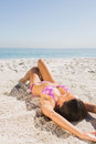 Sexy young woman in pink bikini sunbathing on the beach Royalty Free Stock Photography