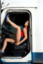 Sexy young woman posing in truck cabin Stock Photography