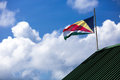 Seychelles flag unfurled against a bright white clouded sky Royalty Free Stock Photos