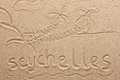 Seychelles handwritten from sand symbol tourism or conceptual designs Stock Images