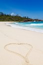 Seychelles la digue island heart drawn in the sand and seascape view with a huge stones Royalty Free Stock Photo