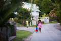 Seychelles village village,a lady and her children walking on the path Stock Photos