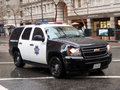 SFPD cop SUV rolls down market street Royalty Free Stock Photo