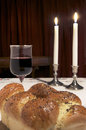 Shabbat celebration items used for candlesticks lit candles challah glass of wine Royalty Free Stock Photos