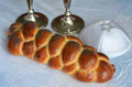 Shabbat eve table with uncovered challah bread candles and kippah Stock Images
