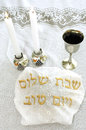 Shabbat jewish holiday eve table with covered challah bread candles and cup of wine Royalty Free Stock Images