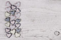 Shabby chic grey wooden background with a collection of hearts o old on the frame Stock Photo