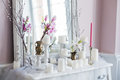 Shabby chic home design. Beautiful decoration table with a candles, flowers in front of a mirror Royalty Free Stock Photo