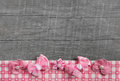 Shabby chic wooden grey background with pink ribbon on white che checked frame for decoration Royalty Free Stock Images