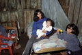 Shabby existence of a family mother with children argentina jujuy province two in her one room shack in the slum los jesuitas in Stock Photo
