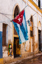 Shabby house in Old Havana with a cuban flag Royalty Free Stock Photo
