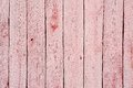 Shabby wooden fence painted pale red Royalty Free Stock Photo