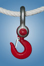 Shackle and hook with screw bolt hanging on a rope Royalty Free Stock Photos