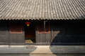 Shaded entrance of ancient chinese house in warm spring sunlight dwelling building chengdu china Stock Image