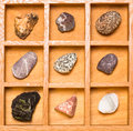 Shadow box with collection of rocks Royalty Free Stock Images