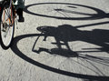 Shadow of cyclist on asphalt road Royalty Free Stock Photos