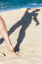Shadow of a girl on the sandy beach Stock Photography