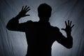 Shadow of man behind dark fabric Royalty Free Stock Photo