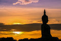 The shadow of seated buddha in evening sunset Royalty Free Stock Photo